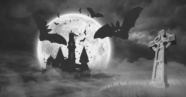 ambientazione cupa con castello pipistrelli e luna piena