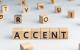 scritta nei cubi della parola accent